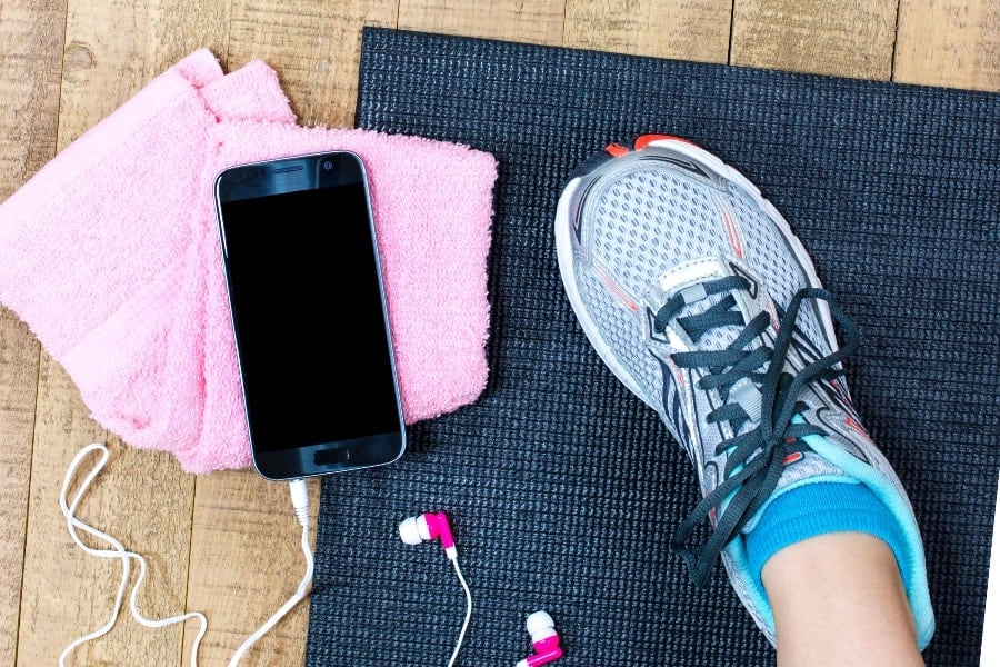 Sports shoes with phone and towel. Best Home Gym Equipment Ideas for Busy People. theothershift.com